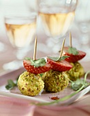 Fresh goat's cheese ball with herbs and strawberry bites