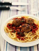 Meat balls in tomato sauce with spaghetti