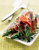 Green asparagus rolled in raw ham and parmesan