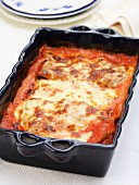 Green lasagnes with beef and pancetta au gratin