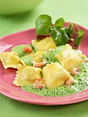 Shrimp raviolis with foamy cress sauce