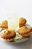Two glasses of Limoncello and Limoncello cup cakes