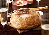 Champagne cheese Fondue served in a round loaf of bread