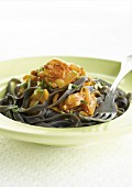Squid ink and quorn tagliatelles with chicory and tomato sauce