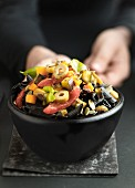 Pasta salad with squid penne, olives, tomatoes, aubergines and peppers