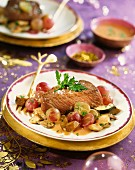 Ostrich steak with pan-fried ceps and grapes