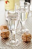 Glasses of Eau-de-vie and dice