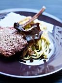 Lamb chop with tagliatelles and mushrooms