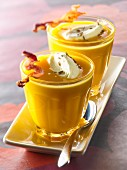 Cream of pumpkin soup with grilled bacon and salted whipped cream