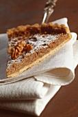 Slice of walnut tart