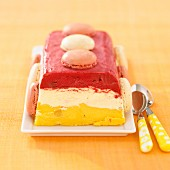 3 flavored ice cream terrine decorated with macaroons