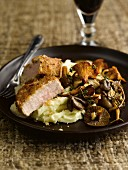 Veal with chestnut and walnut crust,mashed potatoes and pan-fried mushrooms