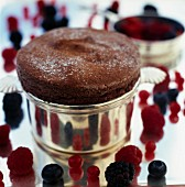 Chocolate souffle with red berries