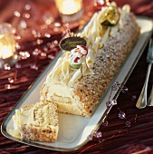 Vanilla, white chocolate and hazelnut Christmas log cake