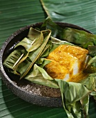Scorpion fish fillets cooked in a banana leaf