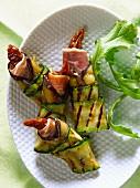 Eggplant,zucchini,raw ham and confit tomato rolls