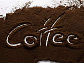 """The word """"coffee"""" written in ground coffee"""