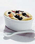 Sweet pudding with apples and blueberries
