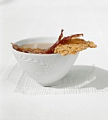 Onion soup with oatmeal, bacon and oatmeal chip