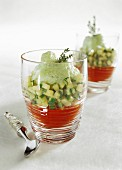 Red pepper puree with zucchini and thyme emulsion in glasses
