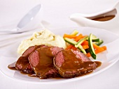 Roast beef with gravy,mashed potatoes and vegetables