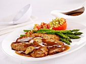 Pork shoulderblade bone with gravy ,green asparagus and provençal-style tomatoes