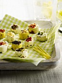 Different flavored mini goat's cheese appetizers
