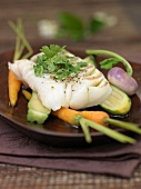 Steam-cooked cod and vegetables with Matcha tea