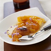 Portion of upside-down apricot tart