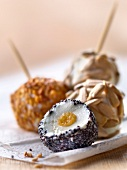 Organic goat's cheese balls coated with different seeds