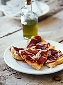 Serrano ham on bread rubbed with tomato and garlic