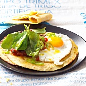 Savoury pancakes with fried egg,tomato and raw spinach