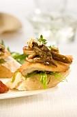 Turkey and pleurotus mushrooms on a bite-size slice of bread