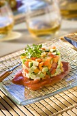 Diced spring vegetable timbale with tomato puree