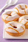 Donuts coated with icing sugar and caramel