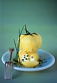 Yellow tomatoes stuffed with goat's cheese and chives