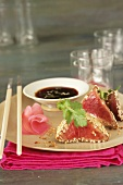 Japanes-style tuna with sesame seed crust, ginger sauce