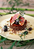 Pan-fried red mullet filets with red quinoa and confit tomatoes