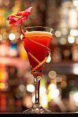 Orange cocktail with flower