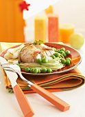 Saddle of rabbit with peas and dandelions