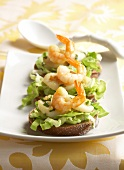 Scallops and shrimps on lettuce open sandwiches