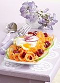 Carrot and beetroot salad with poached egg