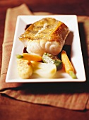 Pike-perch fillet in red wine sauce,gnocchis and carrots