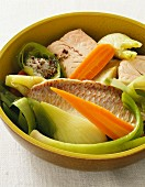 Pot-au-feu with fish, raw vegetables and spices