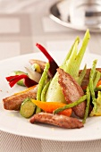 Sliced duck's breast with confit summer vegetables