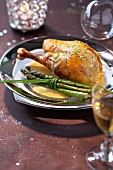Poulard hen in white wine sauce with green asparagus