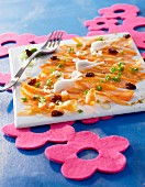 Young carrot carpaccio with spring onions