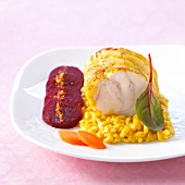 Roast monkfish on a bed of risotto and sliced beetroot