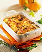 Pumpkin and mushroom cheese-topped dish