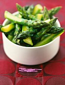 Bowl of green asparagus tops